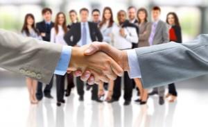 Handshake-with-business-people-behind-us